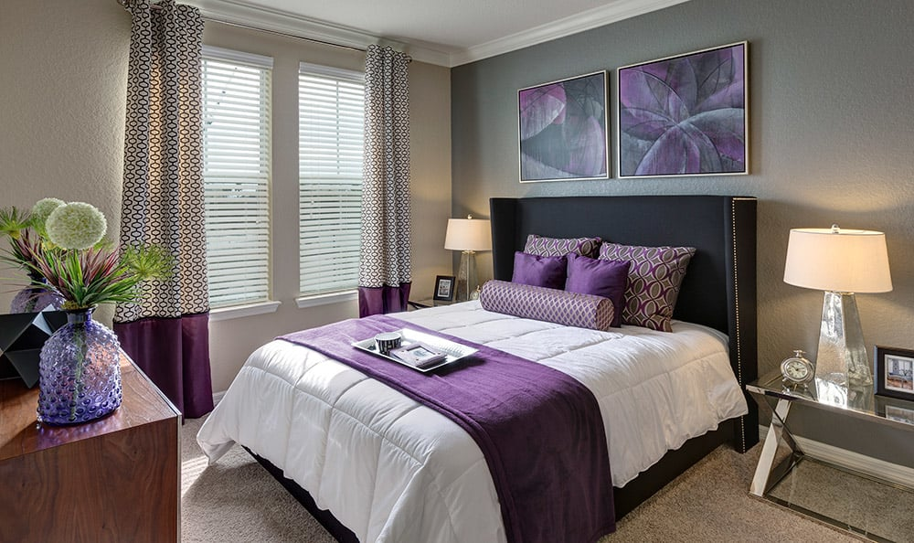 Different master bedroom interior view at luxury apartment home at Integra Cove in Orlando