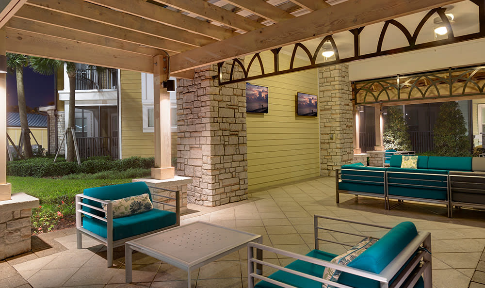 Poolside lounge area at dusk at Integra Cove in Orlando