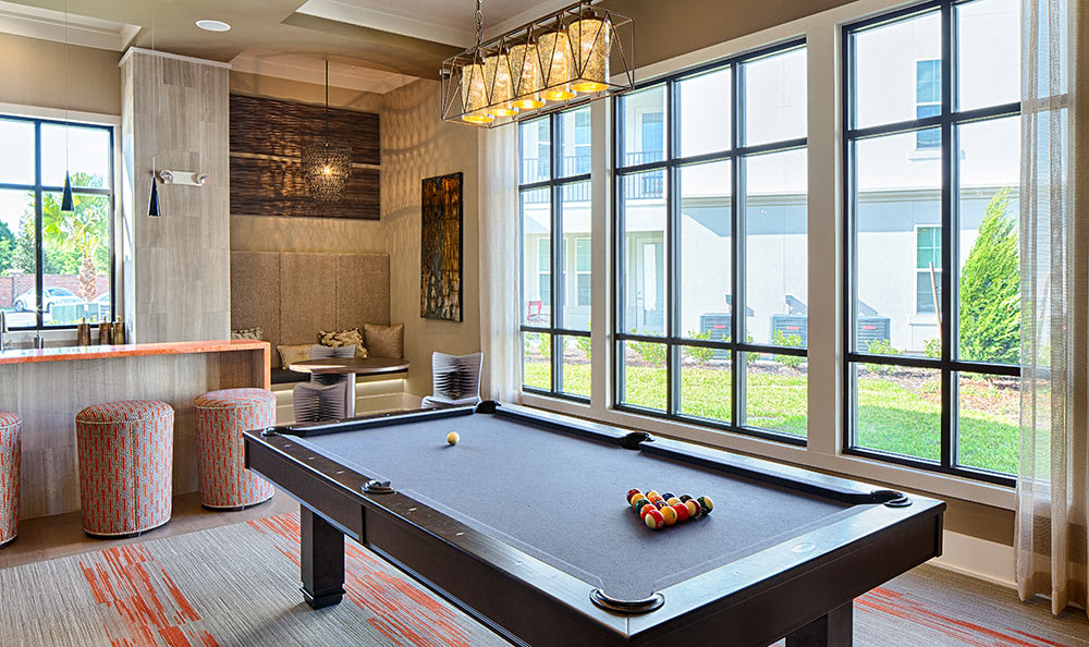Interior of the Park Place at Maguire clubhouse showcasing billiards table