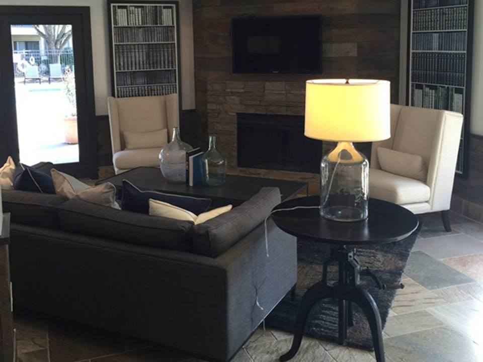 Clubroom with comfy seating and fireplace at Beech Lake Apartments