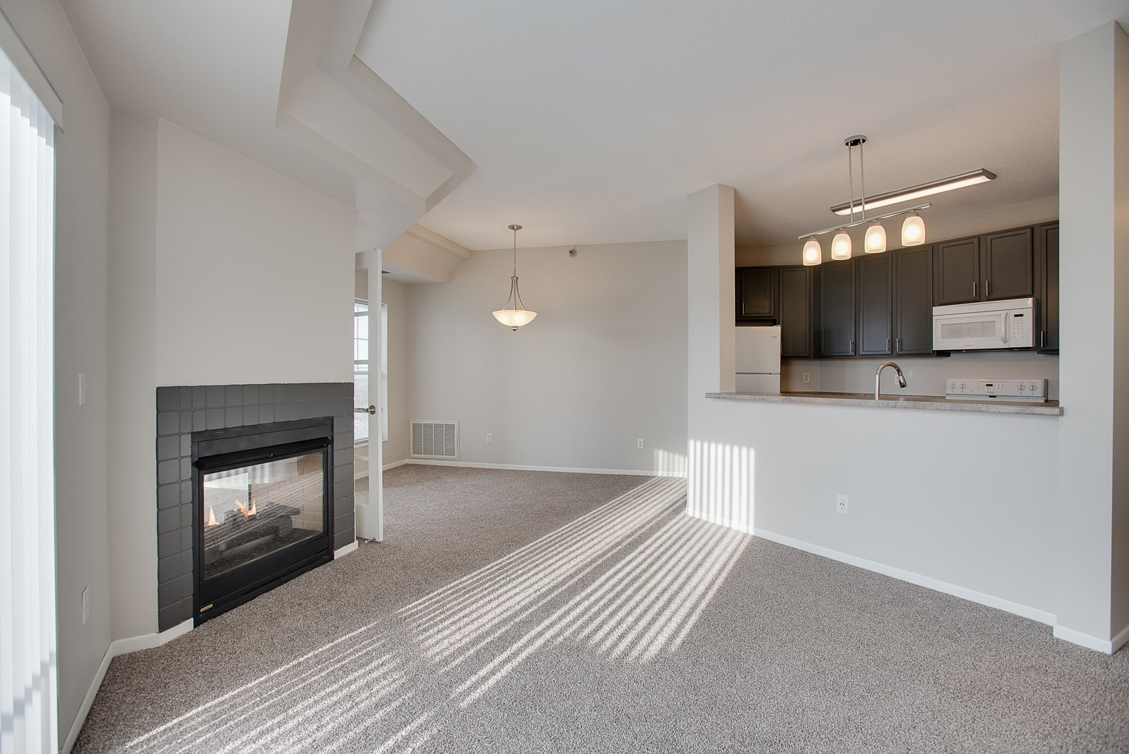 Cozy fireplaces available at Provence Apartments