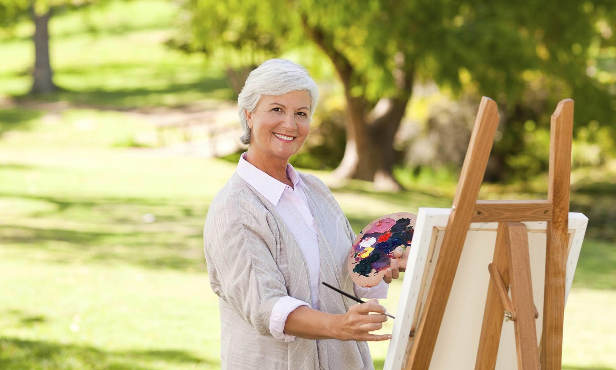 Senior living resident painting in Chico, CA