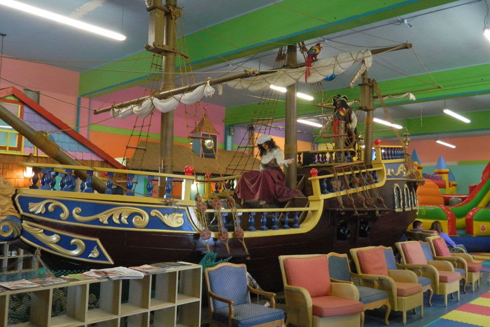 Kids enjoy playing on a replica pirate ship at Aquarium Village