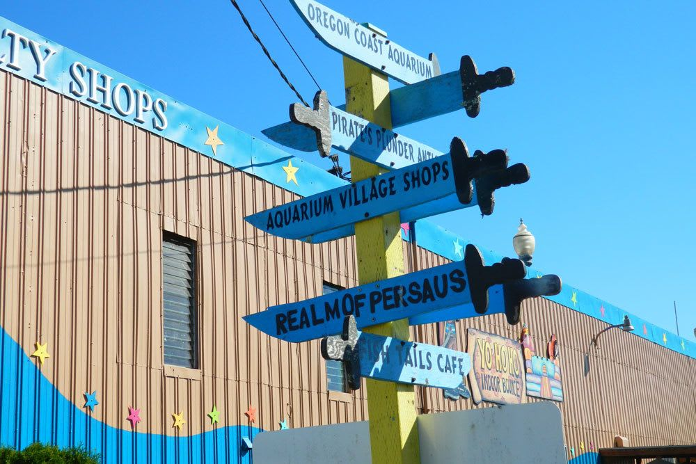 Signs directing visitors to the shops and businesses at Aquarium Village
