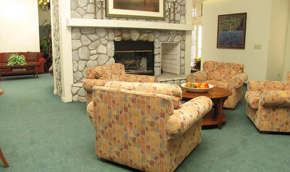 Enjoy the Relaxing Fireplace at the Senior Living community in Grass Valley