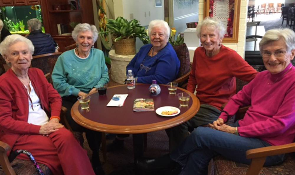 Resdients Enjoying a Drink at the Senior Living community in Grass Valley