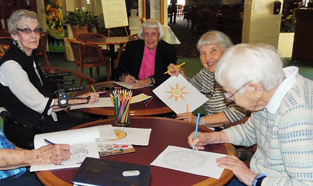 Residents coloring at the senior living community in Grass Valley