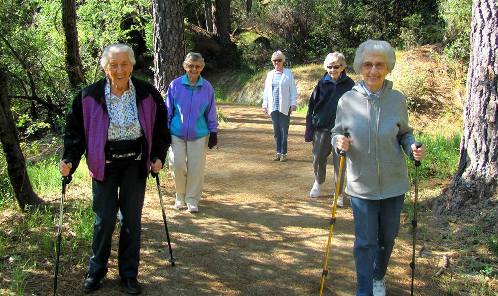 Residents hiking around the senior living community in Grass Valley