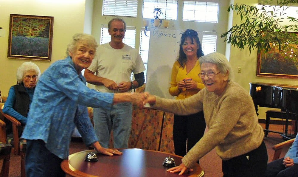 Residents shaking hands at the senior living community in Grass Valley