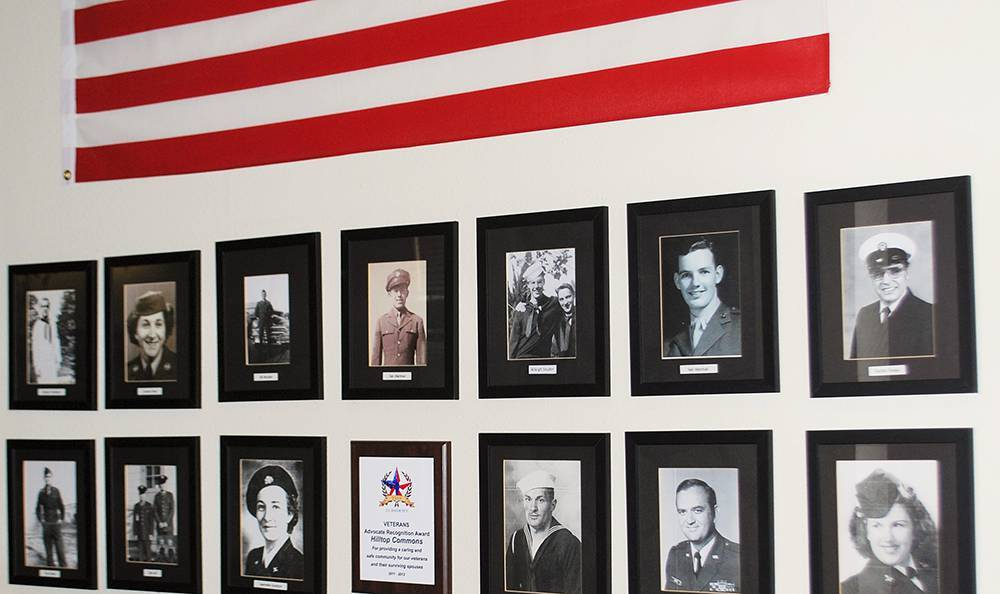 Wall of vet photos at the senior living community in Grass Valley
