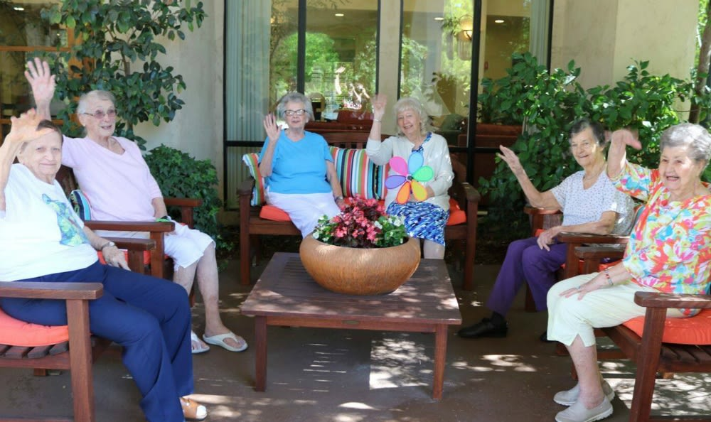 Happy residents enjoying the sunshine at the senior living community in Carmichael