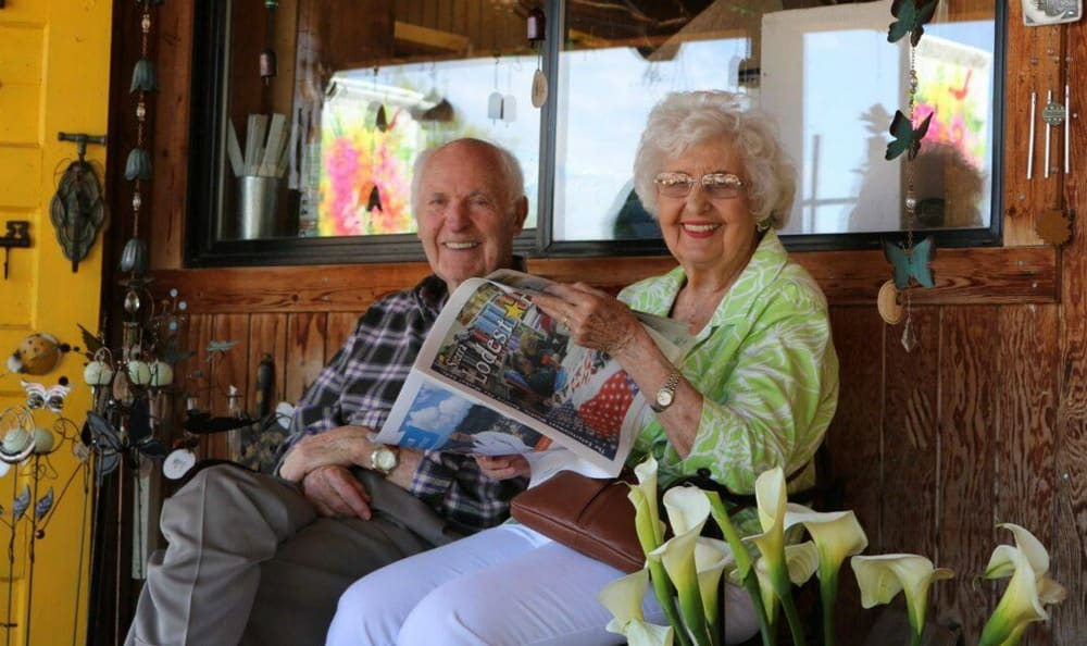 Residents enjoying reading at the Senior Living in Carmichael