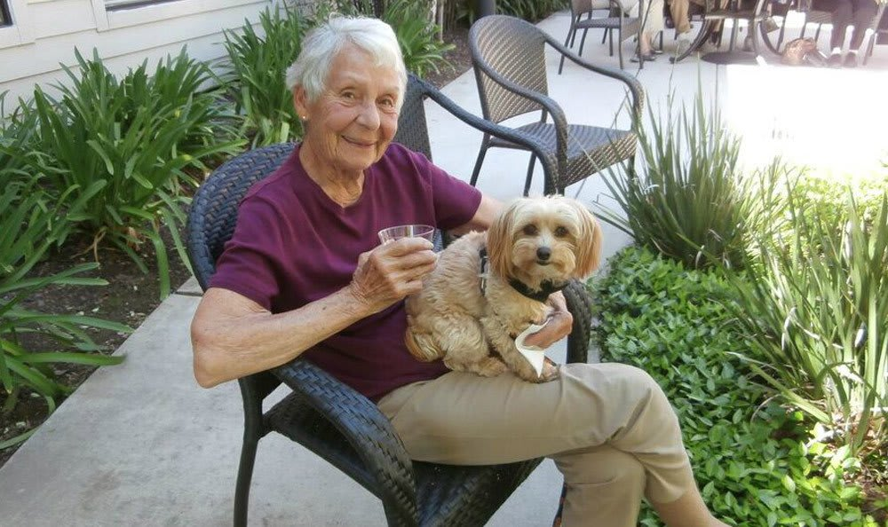 Resident with her dog at the senior living community in Sacramento