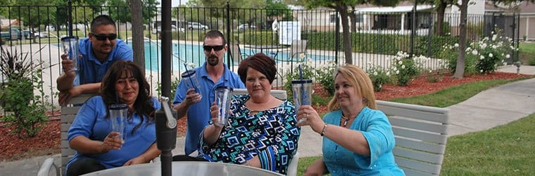 Employees by the pool at the senior living community in Atwater