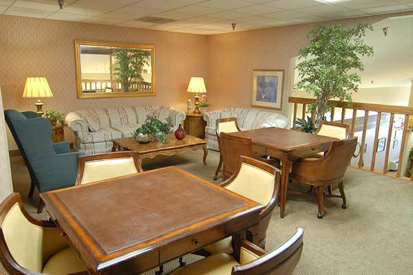 Sit and enjoy a book or socialize in the seating area of River Commons Senior Living.