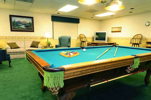 Pool table and game room at River Commons Senior Living.