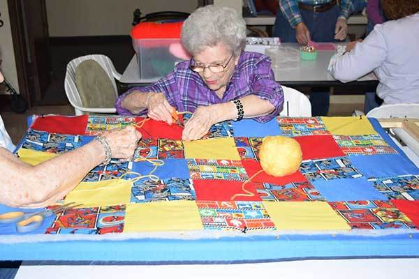 A quilting session at River Commons Senior Living.