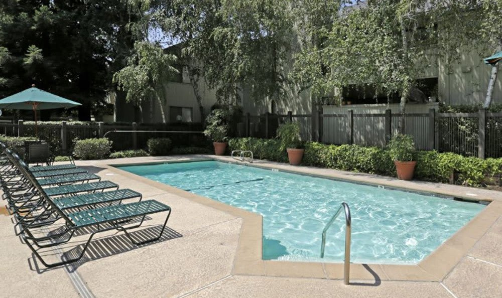Pool-side Seating at Huntcliffe Apartments in Fair Oaks, CA