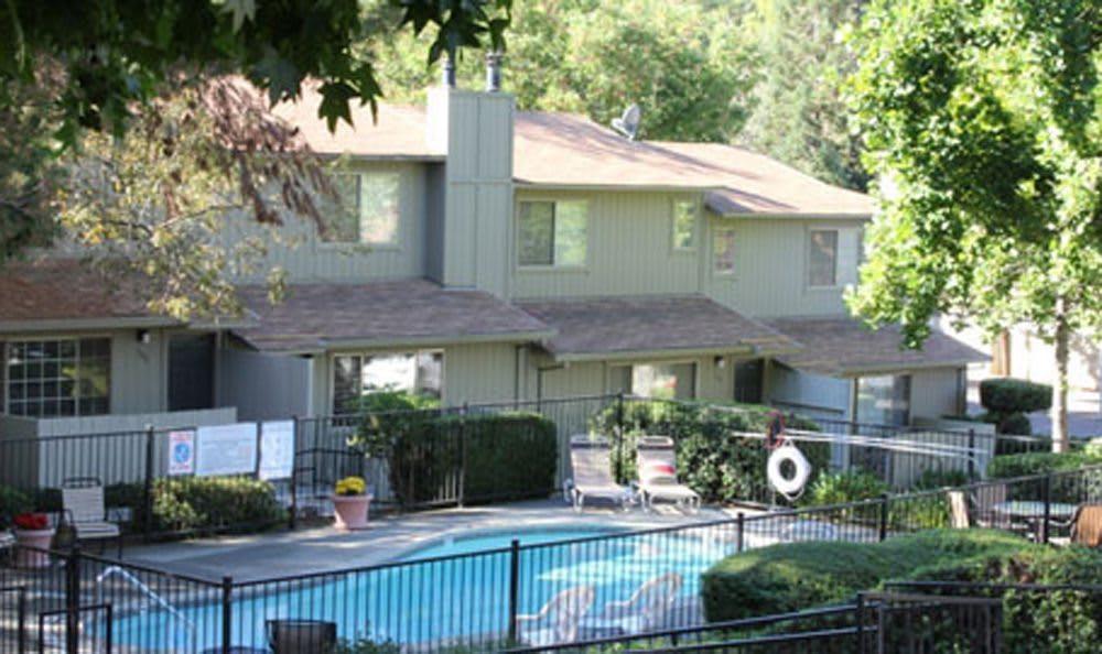 Poolside lounging at Auburn Townhomes in Auburn, California