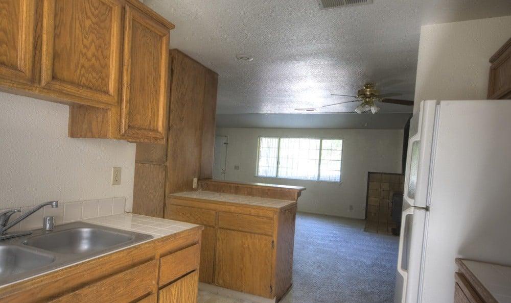 Carpeted living room at Auburn Townhomes in Auburn, California