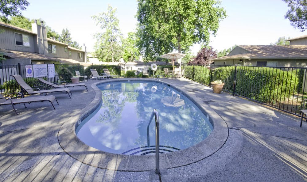 Sparkling outdoor swimming pool at Auburn Townhomes in Auburn, California