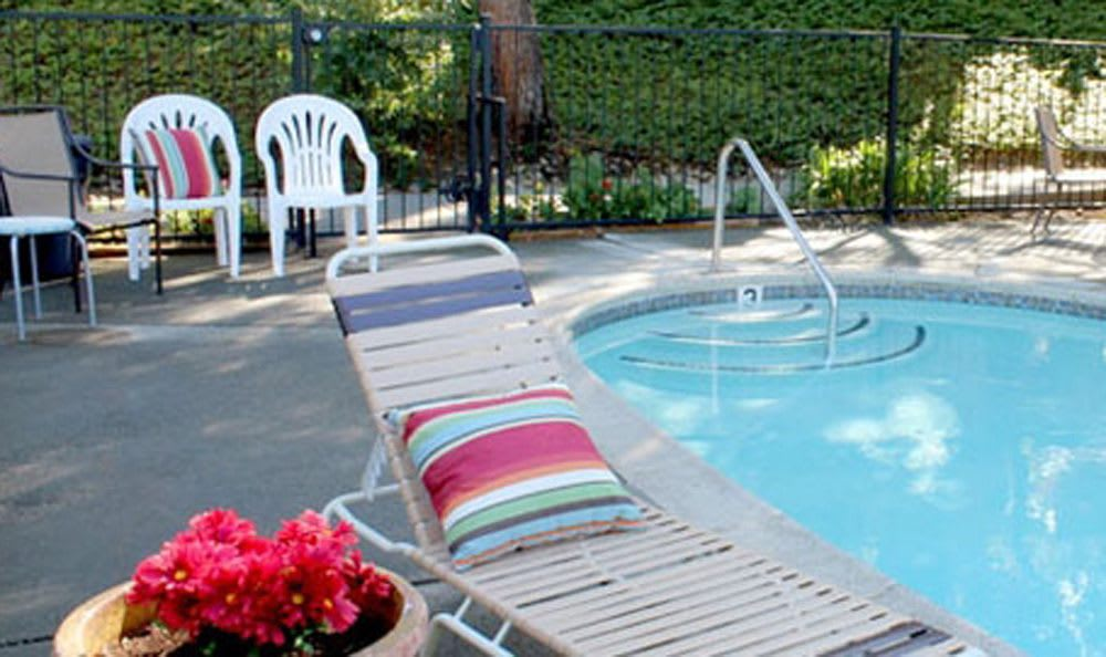 Pool seating at Auburn apartments