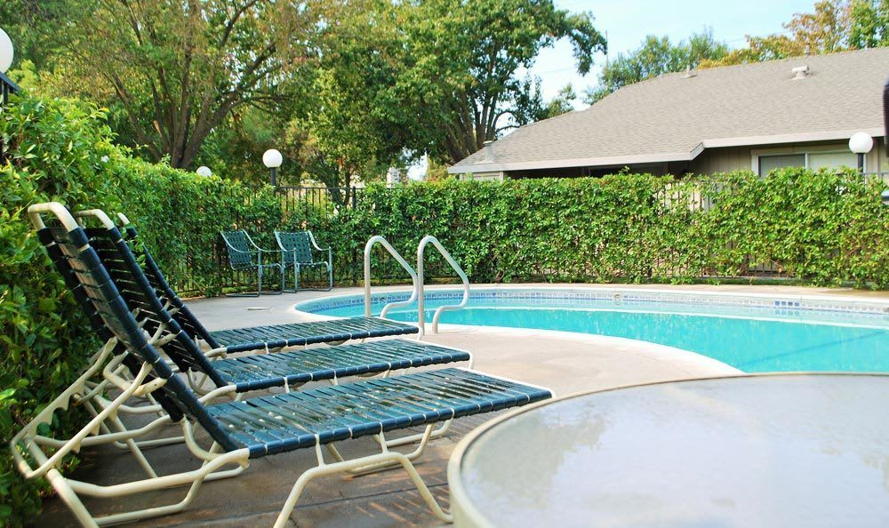 Lounging at the pool at apartments in Lodi, CA