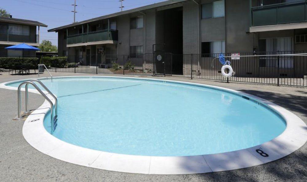 Sparkling pool of Coralaire Apartments in Sacramento, California