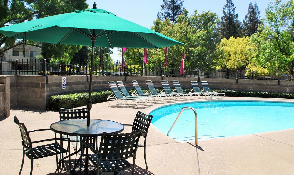 Poolside lounging at Zinfandel Ranch Apartments in Rancho Cordova, CA