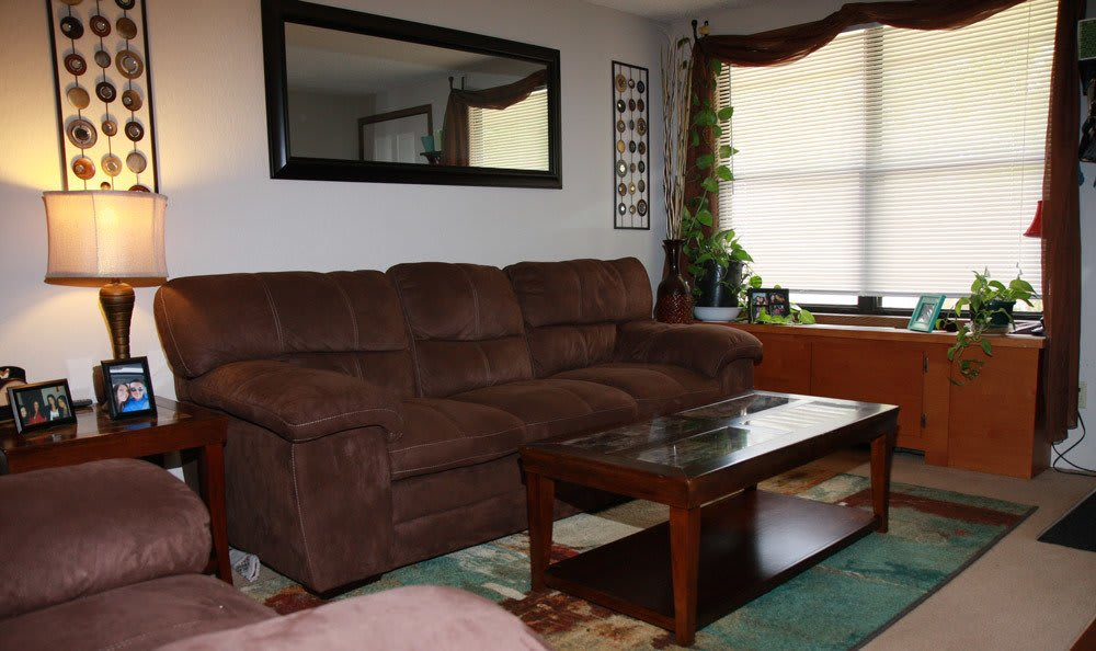Model Living Room At Beckford Place Apartments With Couch And Table
