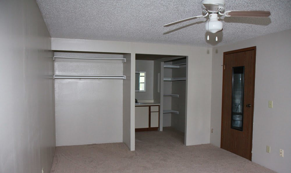 Bedroom At Northrup Court Apartments With Ceiling Fan And Closet