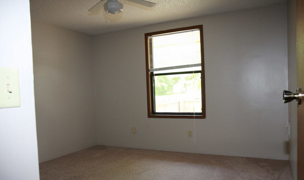 Bedroom At Northrup Court Apartments With Ceiling Fan And Window