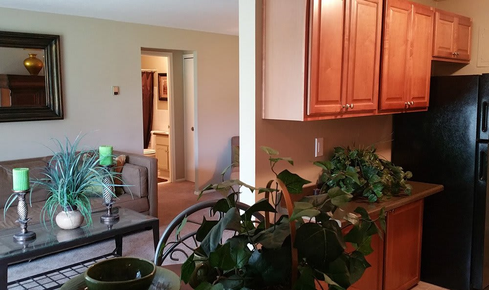 Kitchen And Living Room At Dorchester Village Apartments In Richmond Heights