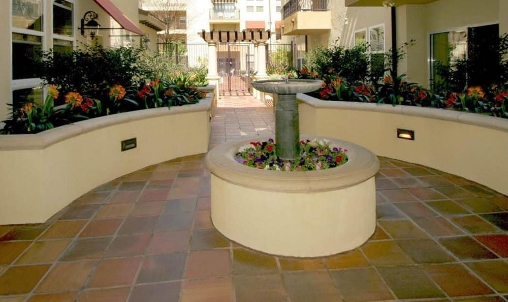 Exterior Of The Villagio With Flowers And Fountain