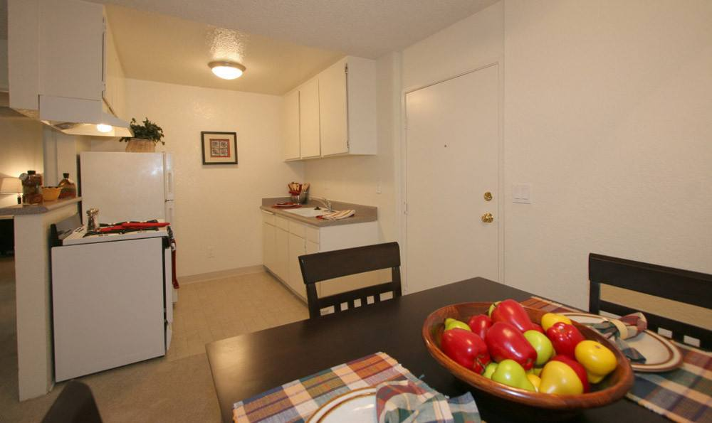 Dining room and kitchen at Embassy Apartments in Sherman Oaks, California