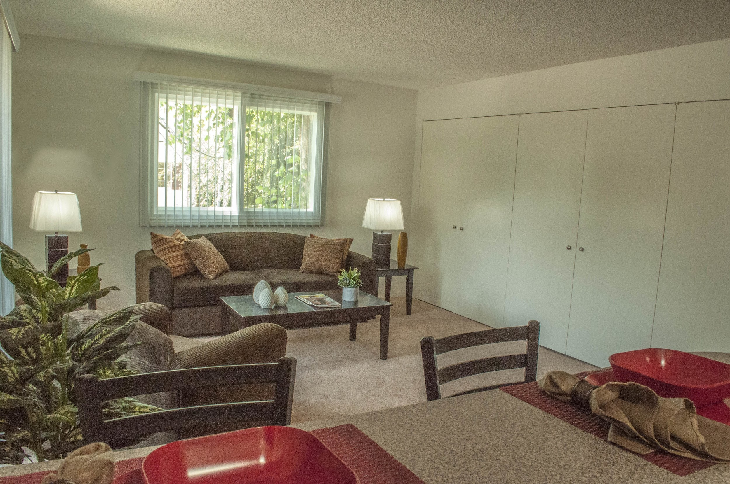 Naturally lit spacious living room at Embassy Apartments in Sherman Oaks, California