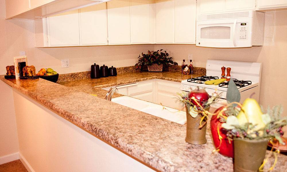 Kitchen with bar at The Ritz in Studio City,
