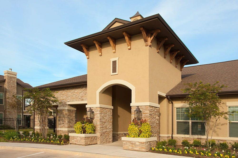 A view of the entryway to The Boulders on Fern Apartment Homes community