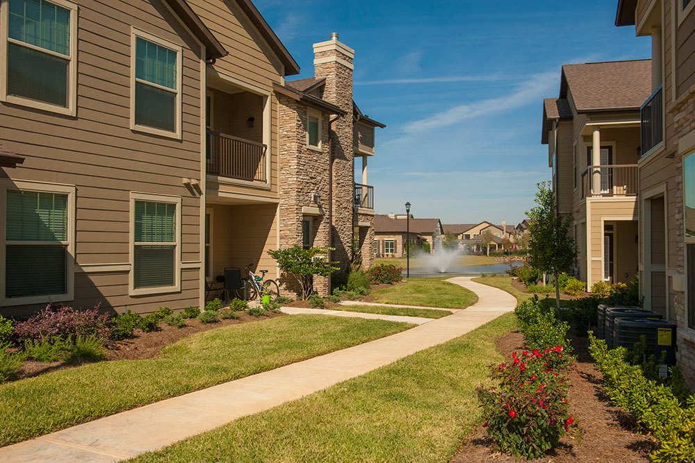 A view of the pathway through landscaped grounds between our Shreveport apartments