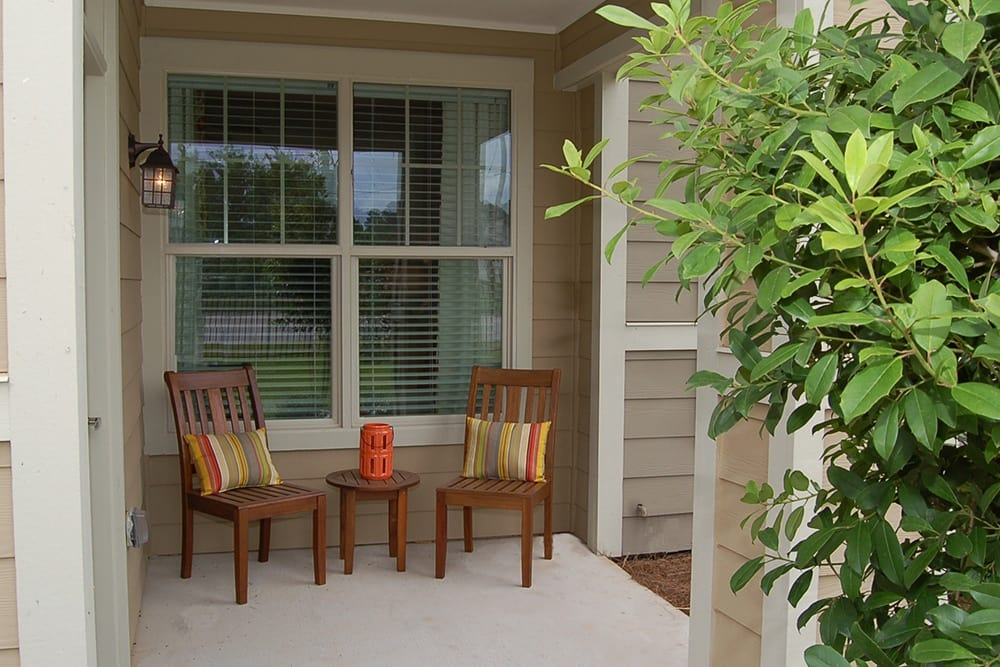 Homes at The Boulders on Fern Apartment Homes feature charming private patios to relax on