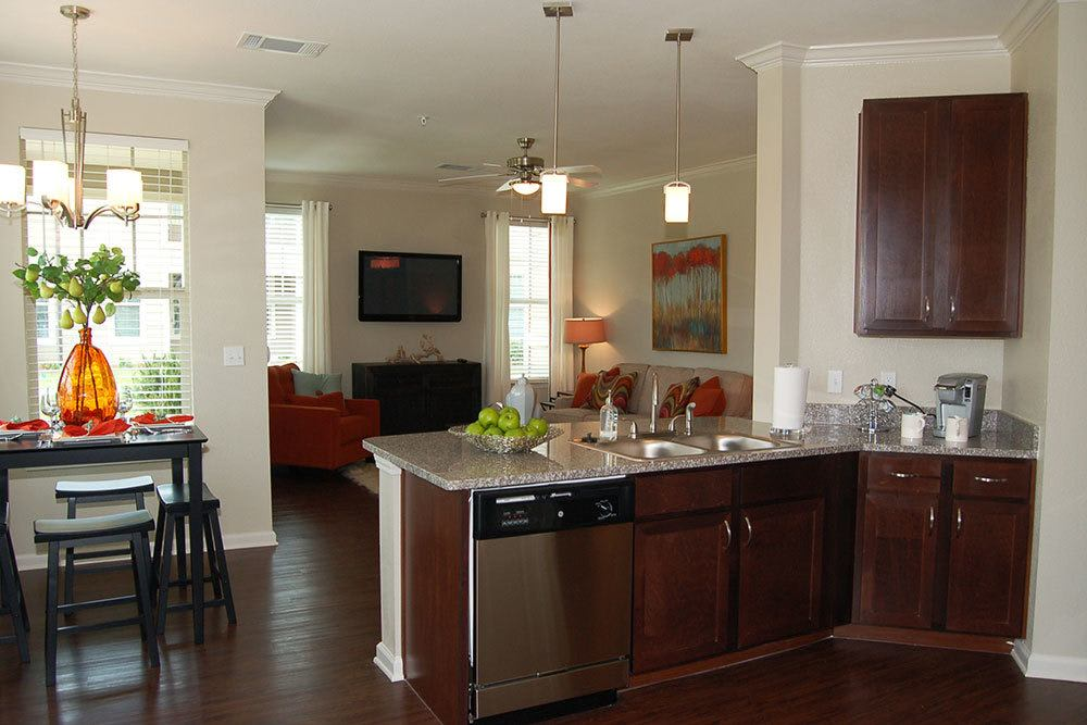 Kitchens featuring custom cabinetry and energy efficient appliances at The Boulders on Fern Apartment Homes