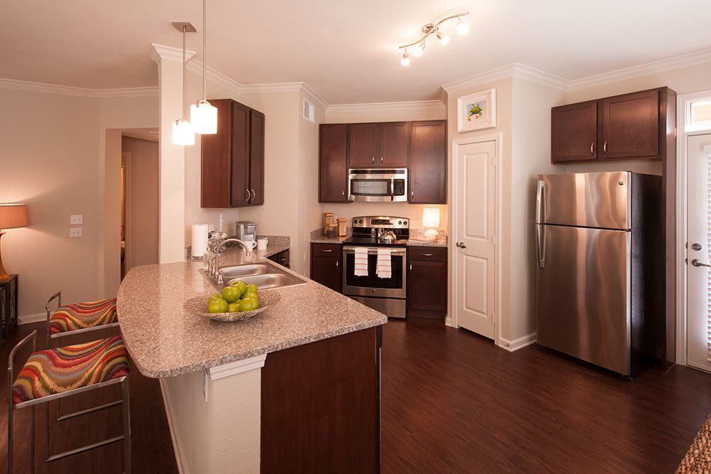 The Boulders on Fern Apartment Homes kitchens feature modern stainless steel appliances
