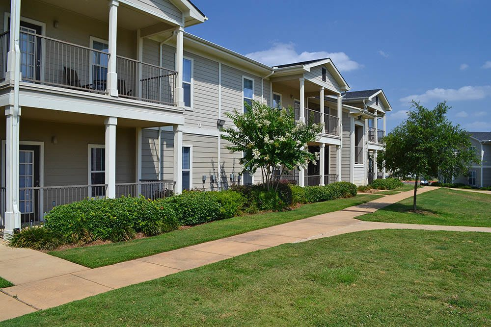 View of the apartment exteriors at The Village at Westlake Apartment Homes