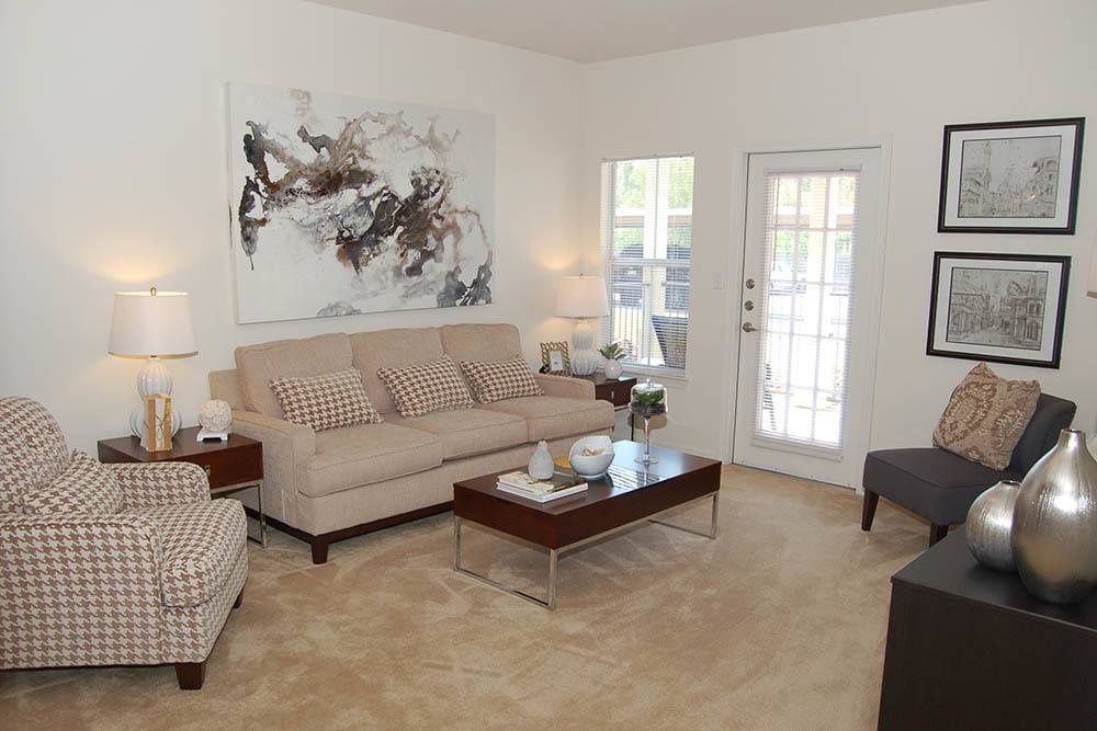 A living room at The Village at Westlake Apartment Homes