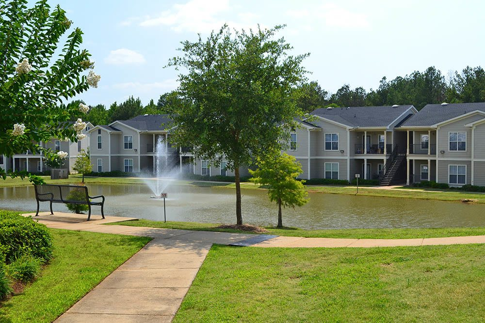 Outdoor walkway and manicured grounds at The Village at Westlake Apartment Homes