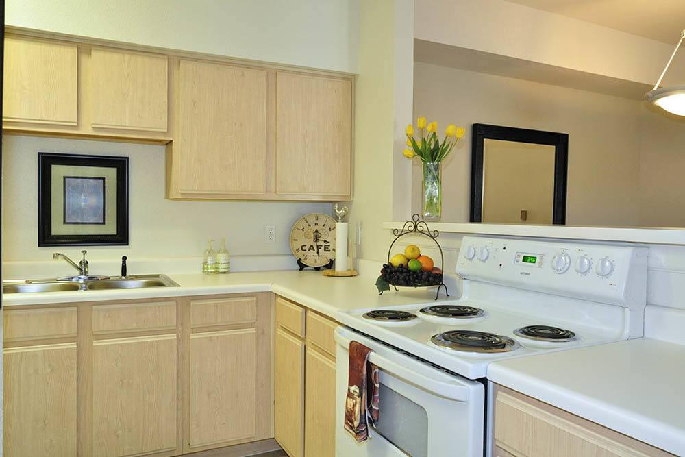 Enjoy cooking in the kitchen of your new apartment at The Village at Westlake Apartment Homes