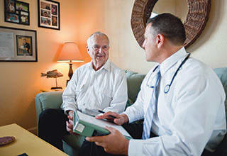 Man talking with doctor at Rittenhouse Village At Lehigh Valley