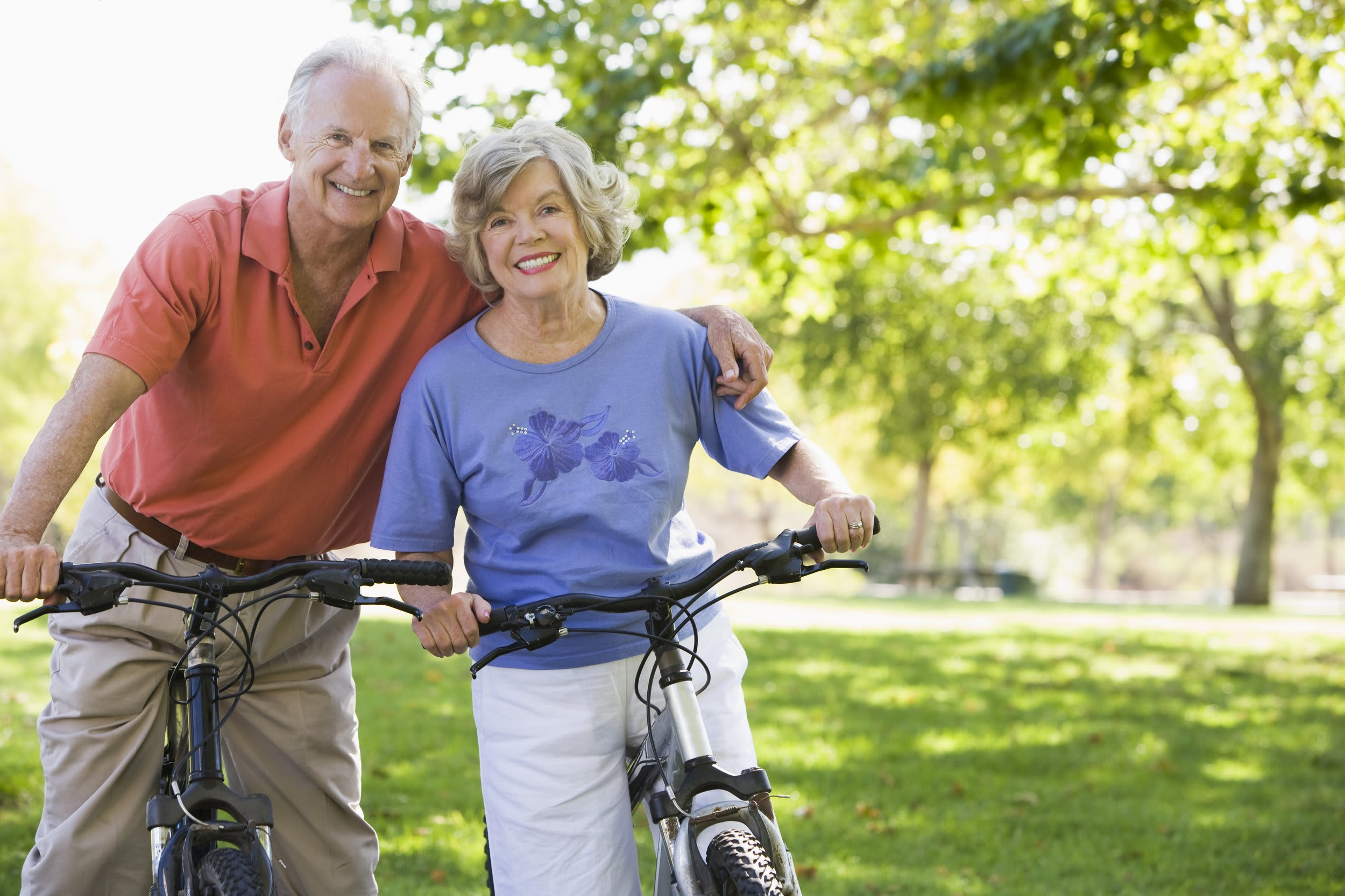 Senior couple enjoying a bike ride at Rittenhouse Village At Portage