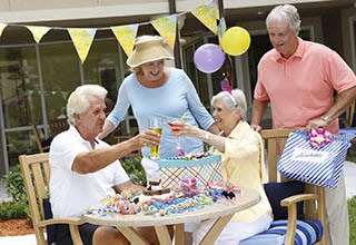 Senior living residents making crafts in Portage