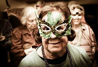 Woman celebrating Mardi Gras at Rittenhouse Village at Floral Vale in Yardley, PA